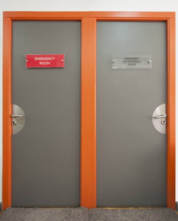 Two office doors in a medical hospital centre to emergency room and management